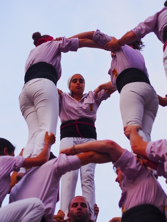 Castells Performance during the Festa Mayor 2013 in Terrassa, Catalonia, Spain. A castell is a human tower built traditionally in festivals at many locations within Catalonia.