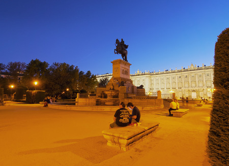iv: Spain, Madrid, Plaza de Oriente, Twilight view of the Monument to Philip IV and the Royal Palace of Madrid.