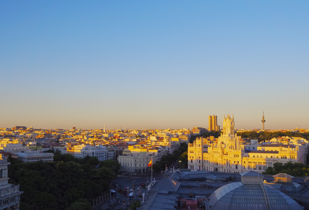 Spain, Madrid, Elevated view of the Cybele Palace at sunset.