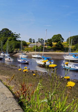 UK, Scotland, Lothian, Edinburgh Area, Cramond Village, Boats in the port at low tide. Editorial
