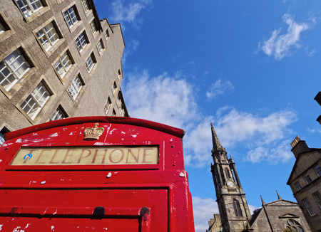 UK, Scotland, Edinburgh, Royal Mile, View of the Red Telephone Box and the Tron Kirk. Stock Photo