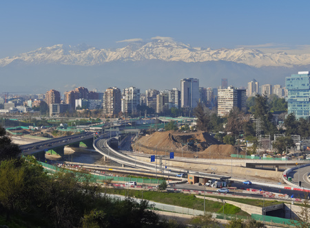 Chile, Santiago, View from the Parque Metropolitano towards the high raised buildings in financial sector. Snow covered Andes in the background.