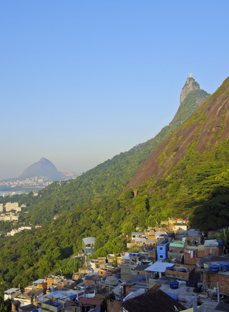 marta: Brazil, City of Rio de Janeiro, View of the Favela Santa Marta  with Corcovado and the Christ Statue behind. Stock Photo