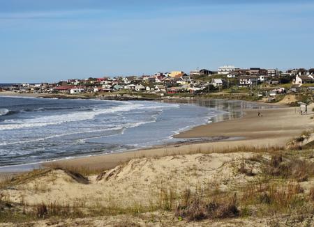 rocha: Uruguay, Rocha Department, Punta del Diablo, View over Rivero Beach towards the village. Stock Photo