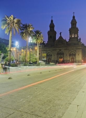 Chile, Santiago, Twilight view of the Plaza de Armas and the Metropolitan Cathedral.