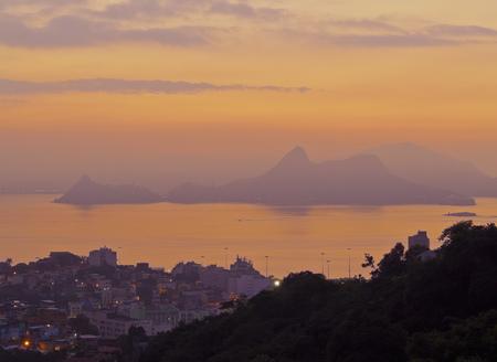 gloria: Brazil, City of Rio de Janeiro, Sunrise view over Gloria towards Niteroi from Mirante do Rato Molhado in Santa Teresa.