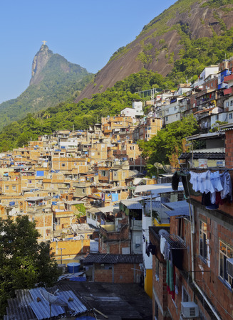 Brazil, City of Rio de Janeiro, View of the Favela Santa Marta  with Corcovado and the Christ Statue behind. Stock Photo