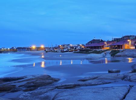 rocha: Uruguay, Rocha Department, Punta del Diablo, Twilight view of the Fisherman's Beach Los Botes.