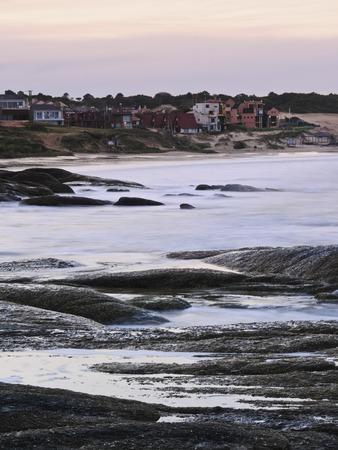 rocha: Uruguay, Rocha Department, Sunset over Punta del Diablo. Stock Photo