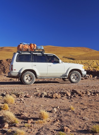 Bolivia, Potosi Department, Toyota Landcruiser on the dirt road of the Sur Lipez Province. Editorial