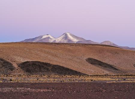 avaroa: Bolivia, Potosi Departmant, Sur Lipez Province, Eduardo Avaroa Andean Fauna National Reserve, Sol de Manana, Nightfall view towards Volcano Uturuncu.