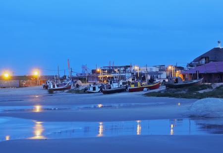 rocha: Uruguay, Rocha Department, Punta del Diablo, Twilight view of the Fisherman�s Beach Los Botes.