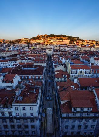 baixa: Portugal, Lisbon, Miradouro de Santa Justa, View over downtown and Santa Justa Street towards the castle hill at sunset.