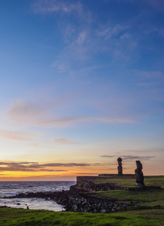 Moais in Tahai Archaeological Complex at sunset, Rapa Nui National Park, Easter Island, Chile