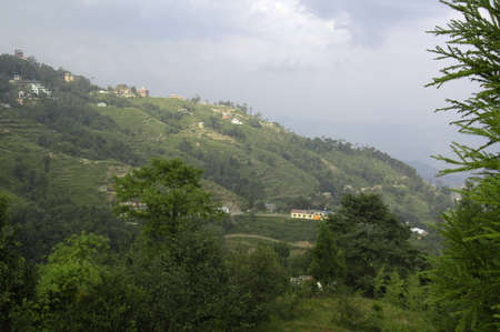 Terraces and buildings near Nagarkot. Taken here in the foothills of the Himalayan Mountains on a rainy overcast day, Nepal Stock fotó - 104427404