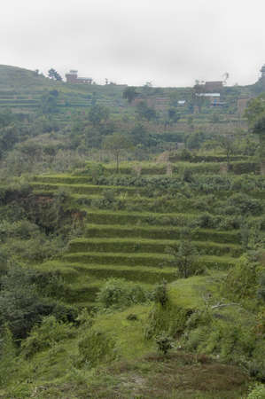 Terraces and buildings near Nagarkot. Taken here in the foothills of the Himalayan Mountains on a rainy overcast day, Nepal Stock fotó - 104427413