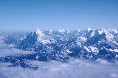 Himalayan mountains. The world's highest mountains photographed here from an aircraft flying at 25,000 feet of Altitude, Nepal 免版税图像
