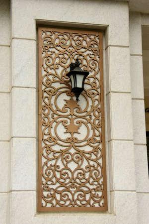 Wall light. A light fixture mounted on a decorative wall panel . Stock Photo - 105415131