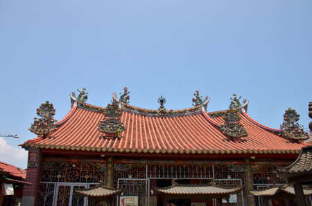 Roof decor. Colourful carvings adorn the roof of this temple in the centre of Georgetown, Malaysia