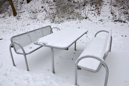 Covered in snow, this picnic table was found in a highway rest stop in Germany Stock fotó