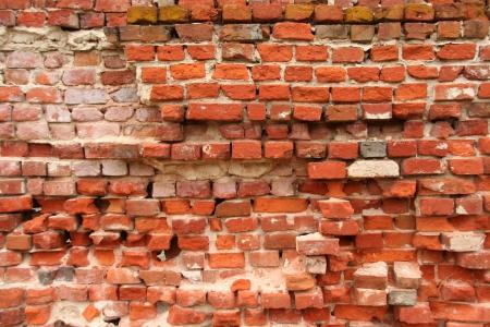 crumbling: Crumbling Brick Wall Stock Photo