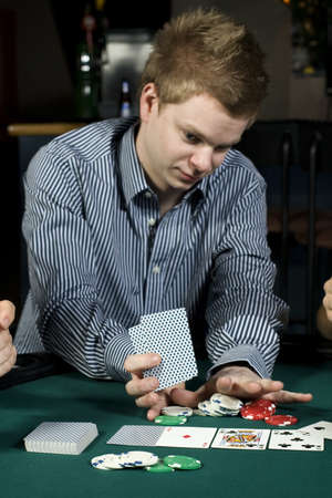 all in: Young poker player going all in during game