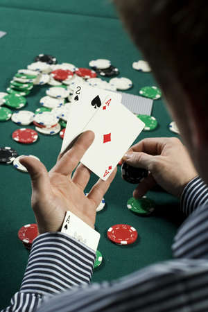 the sleeve: Cheating poker player with ace up his sleeve