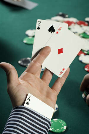 sleeve: Cheating poker player with ace up his sleeve