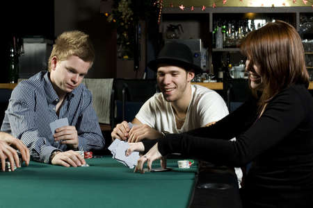 bar: People playing poker around table in bar