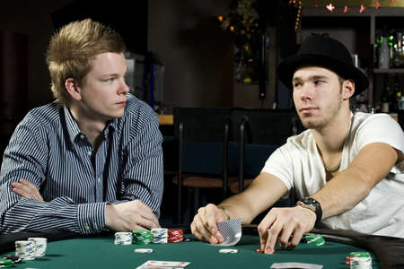 card player: Two poker players concentrating on the game trying to read eachother