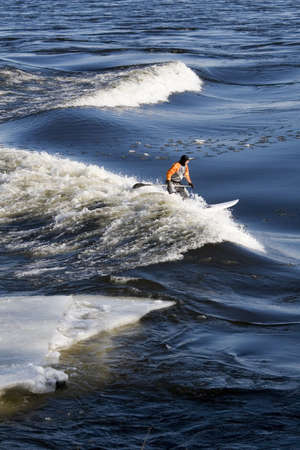 Surfer surfing wave with iceberg beside him  Stock Photo - 4428891
