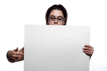 Young woman pointing at white board with isolated background Stock Photo - 4977054