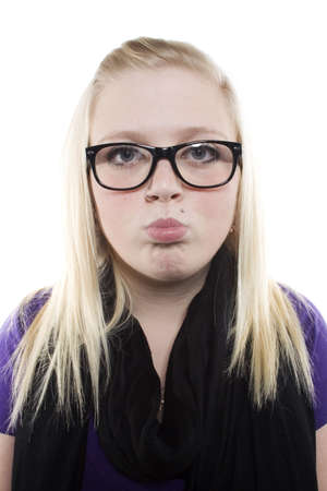 puckering: Young blonde girl with glasses puckering her lips