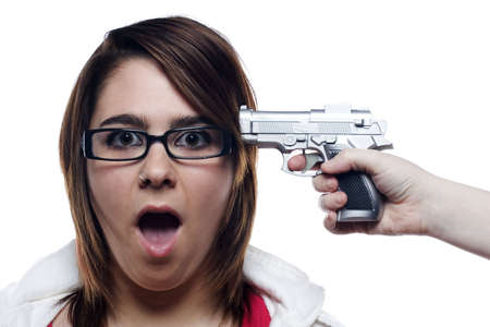 hand: Young woman with gun to head in shock
