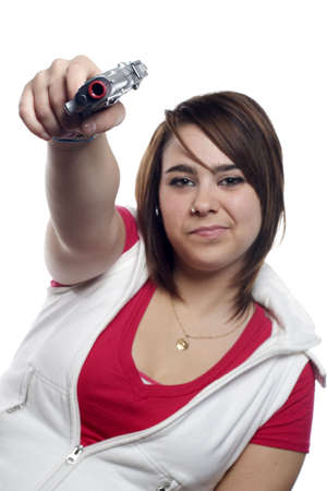 tough: Girl with toy gun in hand pretending to be tough