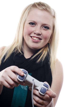 Beautiful young blonde girl playing video games photo