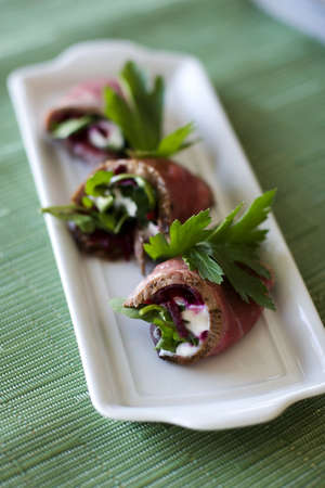 Beef rolls with beets and sour cream inside photo