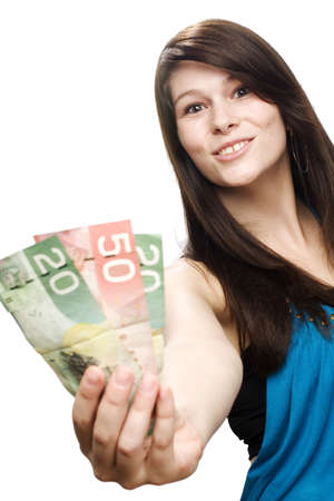 Young woman holding canadian currency and very excited Stock Photo