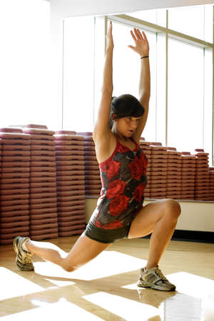 lunges: Young woman lunging in work out room