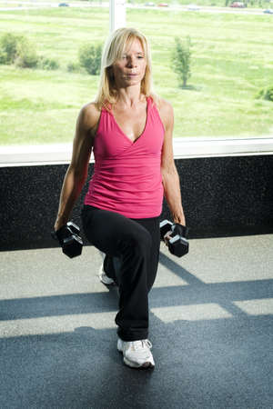 Middle aged woman working out with weights Stock Photo - 8257003