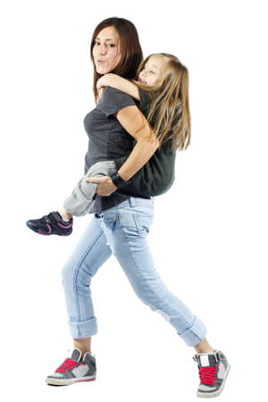 carry: Mother giving her daughter a piggyback ride against white background