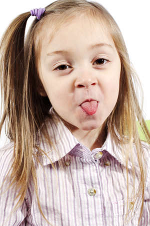 cute attitude: Little girl making silly face for camera on white background Stock Photo