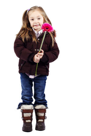 Little girl holding pink flower with winter jacket against white background photo