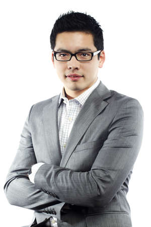 attire: Young asian man in business attire with crossed arms  Stock Photo