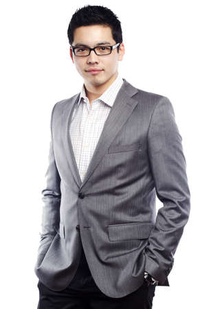 Young asian man looking confident in business attire photo