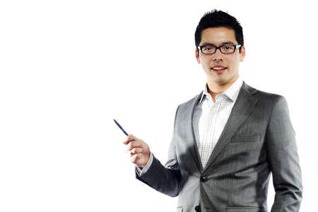 Asian male model: Người đàn ông châu Á trẻ tuổi trong trang phục kinh doanh cầm bút dạy một cái gì đó