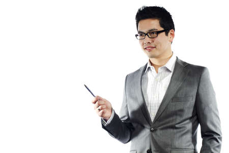 Young asian man in business attire holding pen teaching something Stock Photo - 10292736