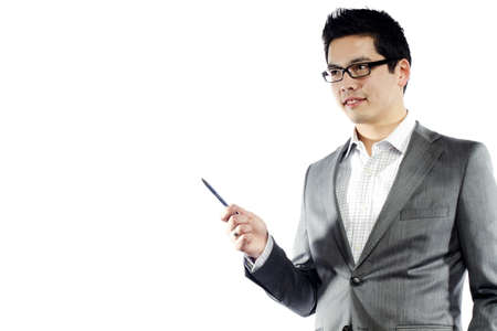 Young asian man in business attire holding pen teaching something Stock Photo - 10292735