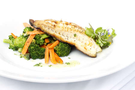 black dish: Fresh black cod on bed of broccoli and carrots with a touch of micro herbs