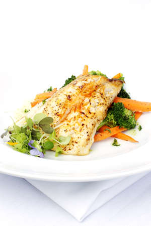 cod fish: Fresh black cod on bed of broccoli and carrots with a touch of micro herbs